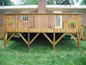 Decks over 4' high must have knee bracing on support posts.