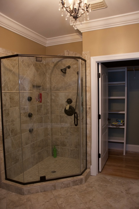 Shower with glass enclosure.