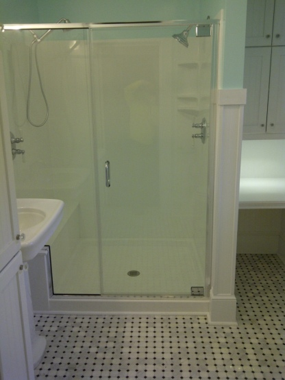 Enclosed shower with glass doors