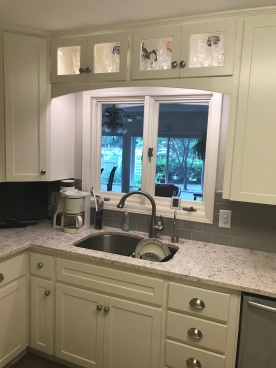 Updated countertops and backsplash with refaced cabinets.